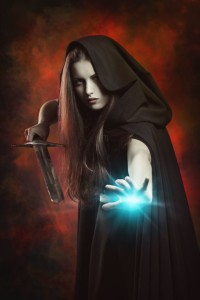 36774374 - beautiful sorceress in fighting position with sword . fantasy and magic